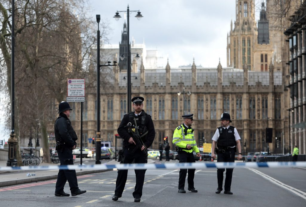 LONDON, ENGLAND - MARCH 22: Armed officers attend to the scene outside Westminster Bridge and the Houses of Parliament on March 22, 2017 in London, England. A police officer has been stabbed near to the British Parliament and the alleged assailant shot by armed police. Scotland Yard report they have been called to an incident on Westminster Bridge where several people have been injured by a car. (Photo by Jack Taylor/Getty Images)